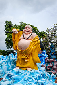 Colourful sculpture of Buddha on water at Haw Par Villa
