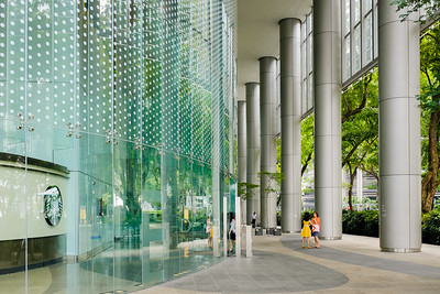 Employees talking in front of office building in Singapore