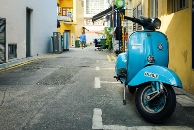 Blue Vespa on a back street in Singapore