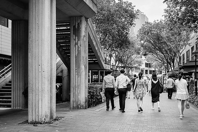 Black and white picture of people walking in Singapore