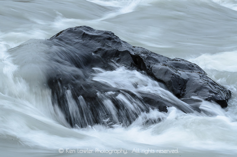 Waves on river rock