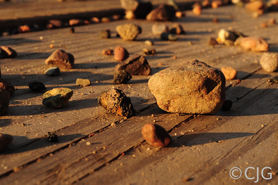 Close up of gravel on wood planks
