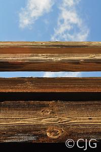 Railing of bridge against sky.