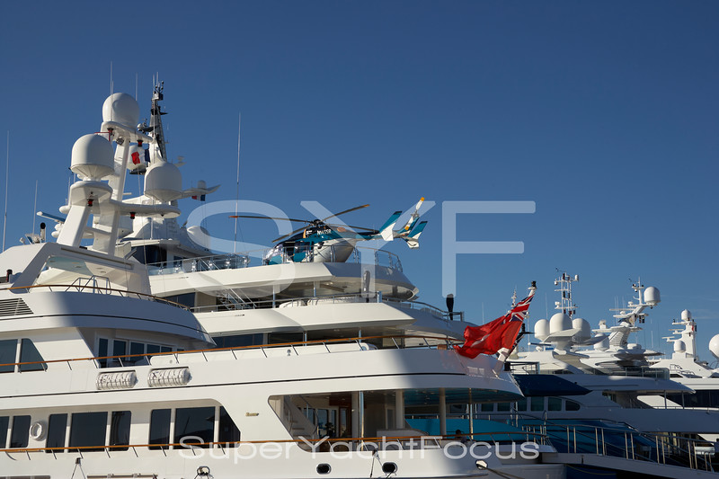 Superyachts in port with helicopter