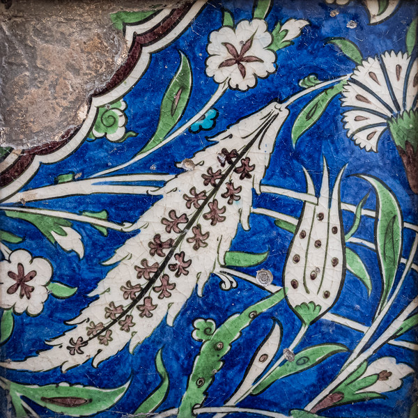 Old tile with white flowers