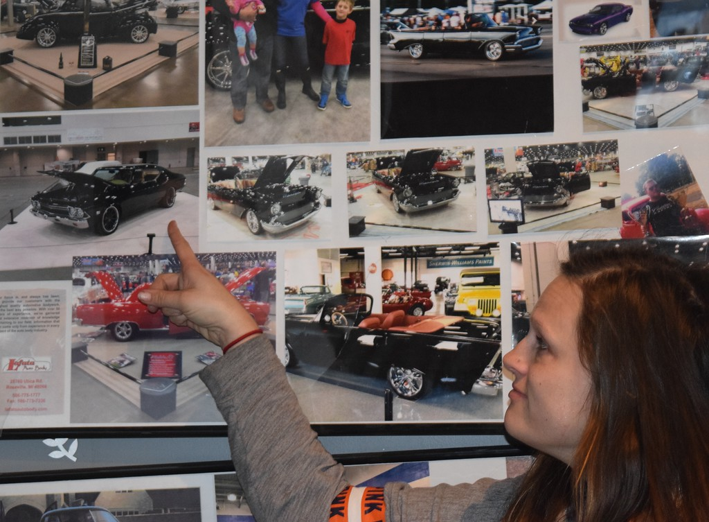 . Sarah Lafata, co-owner of Lafata Auto Body in Roseville points to one of the cars she and her husband, Eric Lafata had on display at a previous Detroit Autorama event.