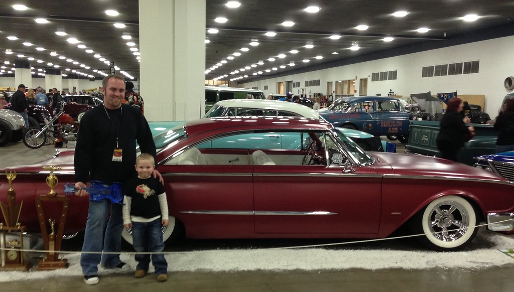 . Chris Herod of St. Clair Shores with his oldest son and his first car, a 1960 Ford Starliner at Detroit Autorama a few years ago. Herod\'s grandfather, Bill Whetstone will be inducted into the Autorama Circle of Champions this year.