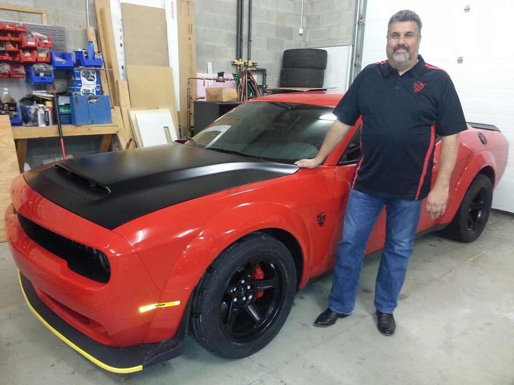 . Kevin Smith of Madison Heights with his red 2018 Dodge Demon.