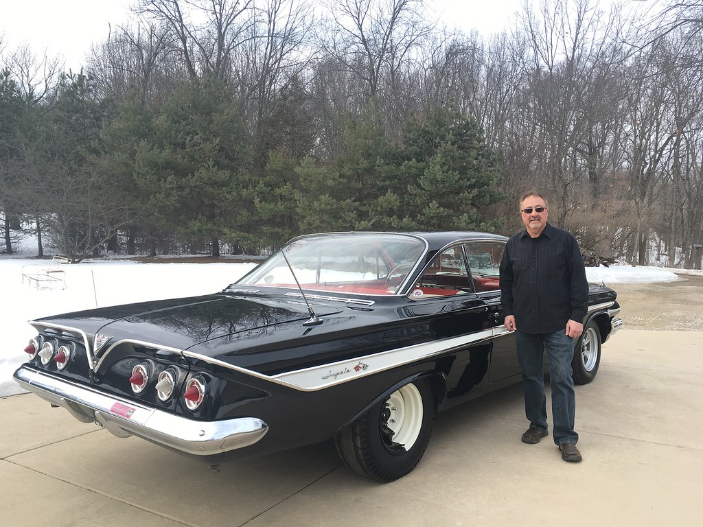 . Chris Fodell of Milford poses with his 1961 Chevrolet Impala.