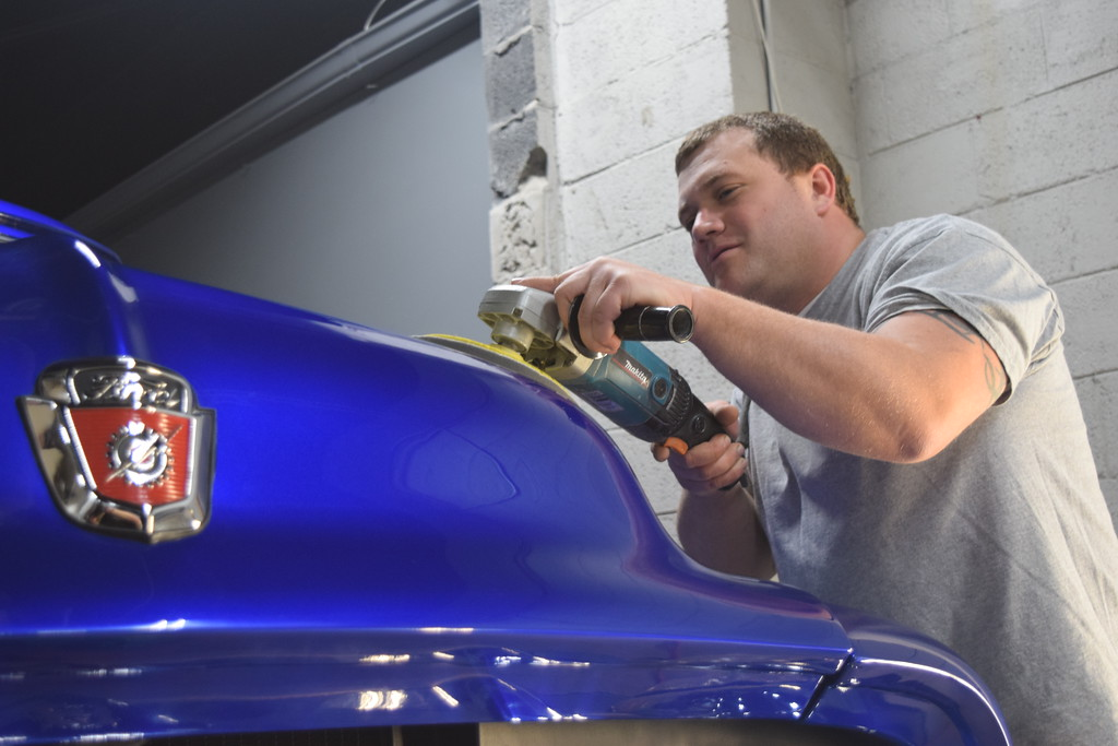 . Eric Lafata, co-owner of Lafata Auto Body in Roseville adding a little more shine to his 1954 Ford F100.