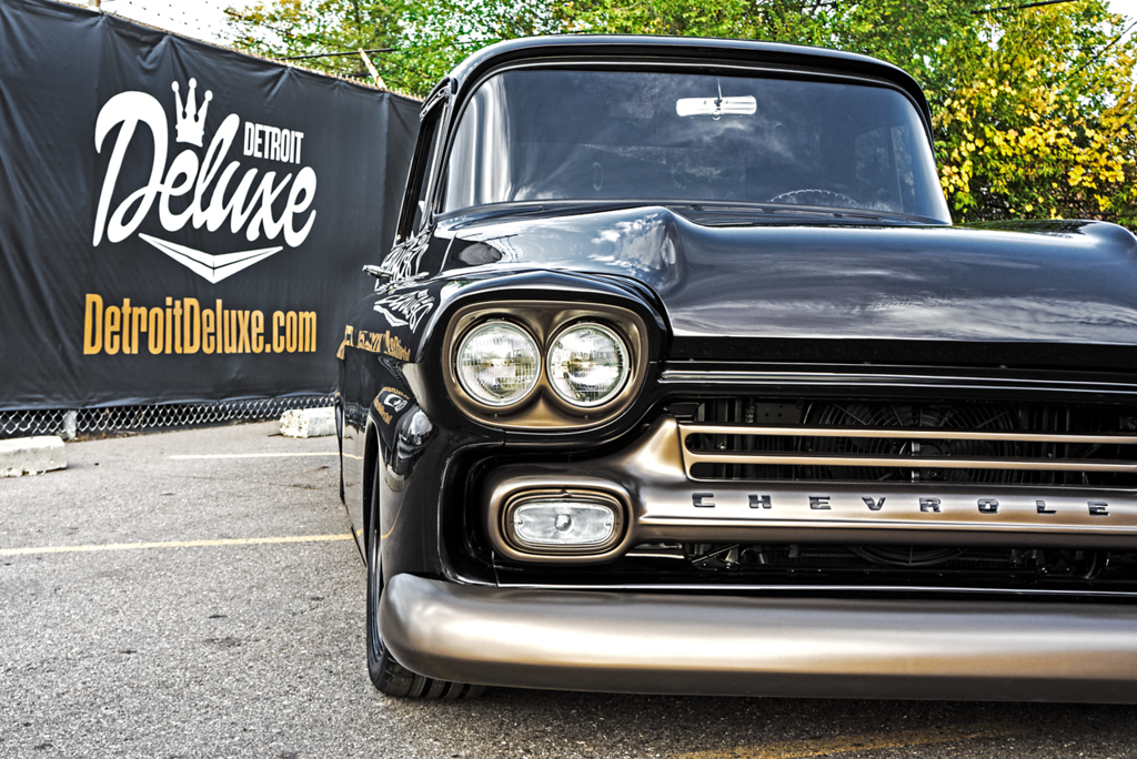 . This 1958 Chevrolet Apache presented by Detroit Deluxe features a custom pearl, root beer finish with color-matched wheels.
