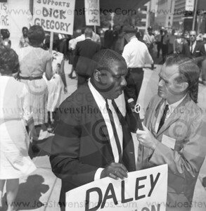 Dick Gregory photographed here in Detroit, MI in 1965 being interviewed by the local Detroit channel 7 News Anchor, during his march for equal education, among other things, with CORE, a civil activist group.  Photograph by Detroit Photographer, Joe Stevens.