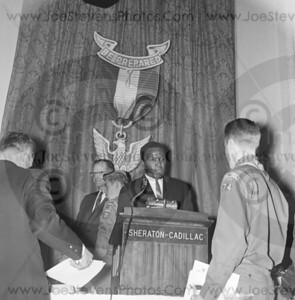 "Rafer Johnson shown here in the mid 1960's at the Detroit Sheraton-Cadillac Hotel Event as key speaker and handing out awards to the Boy Scouts of America.  Joe, the photographer knew of some Rafer Johnson's accomplishments and one being that Rafer was the 1956 Silver and the 1960 Olympic Decathlon Gold Medal Champion. Rafer scored 8,392 points in Decathlon. Rafer carried the American flag during the opening ceremonies that year. And he was Sports Illustrated Sportsman of the Year in 1959. Rafer was also an actor and appeared in such films like ""Wild in the Country"" and ""The Fiercest Heart"". Rafer later coached popular TV & film actress, Patty Duke, for her role as a decathlon in the movie ""Billie"" produced by Peter Lawford. Rafer was at the hotel in Los Angeles where Bobby Kennedy was shot and killed and helped wrestle down the killer, Sirhan Sirhan. So on this day, Joe, the photographer, was following the big events in the Detroit area and these are the 2 negatives that I found of Rafer Johnson in Detroit."