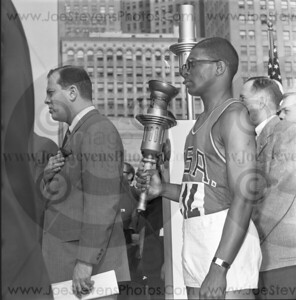 Hayes Jones - Olymic Hurdles Metal winner - shown here in1963 in Detroit after lighting the torch for the new Olympics games. He was one of the Olymians chosen to run across the country with the lighted torch