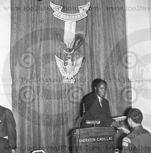 "Rafer Johnson shown here in the mid 1960's at the Detroit Sheraton-Cadillac Hotel Event as key speaker and handing out awards to the Boy Scouts of America.  Joe, the photographer knew of some of Rafer Johnson's accomplishments and one being that Rafer was the 1956 Silver and the 1960 Olympic Decathlon Gold Medal Champion.  Rafer scored 8,392 points in Decathlon.  Rafer carried the American flag during the opening ceremonies that year. And he was Sports Illustrated Sportsman of the Year in 1959. Rafer was also an actor and appeared in such films like ""Wild in the Country"" and ""The Fiercest Heart"".  Rafer later coached popular TV & film actress, Patty Duke, for her role as a decathlon in the movie ""Billie"" produced by Peter Lawford. Rafer was at the hotel in Los Angeles where Bobby Kennedy was shot and killed and helped wrestle down the killer, Sirhan Sirhan.  So on this day, Joe, the photographer,  was following the big events in the Detroit area and these are the 2 negatives that I found of Rafer Johnson in Detroit."