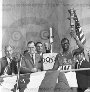 Hayes Jones -  Olymic Hurdles Metal winner - shown here in1963 in Detroit after lighting the torch for the new Olympics games.  He was one of the Olymians chosen to run across the country with the lighted torch.