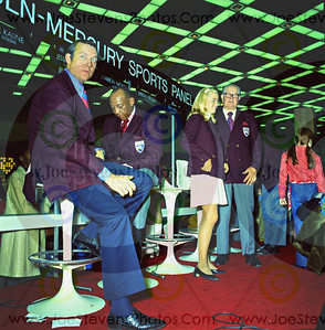 Jesse Owens, Olympic Medalist at the 1970 Detroit International Auto Show on the Lincoln-Mercury Sports Panel sitting next to Al Kaline of Baseball fame.