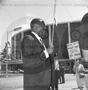 Dick Gregory marching out in front of Cobo Hall downtown Detroit in 1965 with CORE, a civil rights activist group.  Dick Gregory was a Comedian in his profession and also used that platform into crossing the line into equality and with his performances, conveyed his message on Civil Rights.
