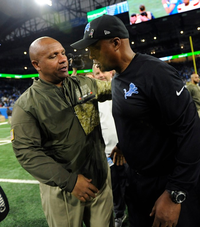. Cleveland Browns head coach Hue Jackson, left, greets Detroit Lions head coach Jim Caldwell after their NFL football game, Sunday, Nov. 12, 2017, in Detroit. (AP Photo/Jose Juarez)