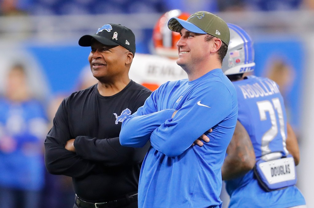 . Detroit Lions head coach Jim Caldwell, left, talks with offensive coordinator Jim Bob Cooter during pregame of an NFL football game, Sunday, Nov. 12, 2017, in Detroit. (AP Photo/Paul Sancya)