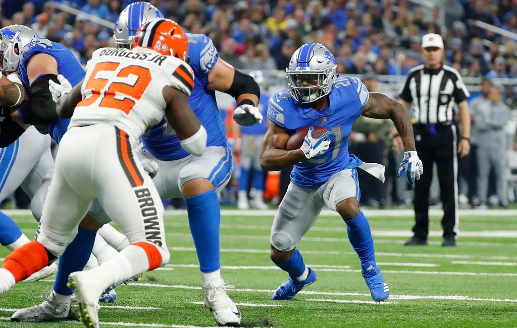 . Detroit Lions running back Ameer Abdullah (21) rushes for an 8-yard touchdown during the first half of an NFL football game against the Cleveland Browns, Sunday, Nov. 12, 2017, in Detroit. (AP Photo/Rick Osentoski)