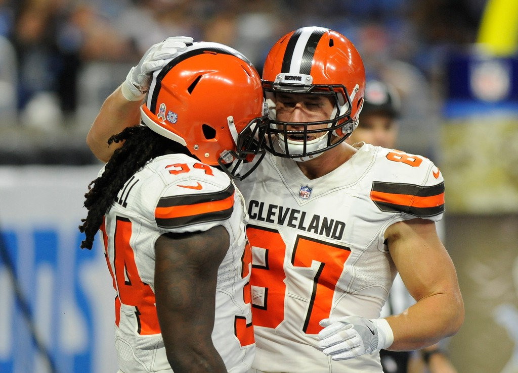 . Cleveland Browns running back Isaiah Crowell (34) is congratulated by tight end Seth DeValve (87) after rushing for a 6-yard touchdown during the second half of an NFL football game against the Detroit Lions, Sunday, Nov. 12, 2017, in Detroit. (AP Photo/Jose Juarez)
