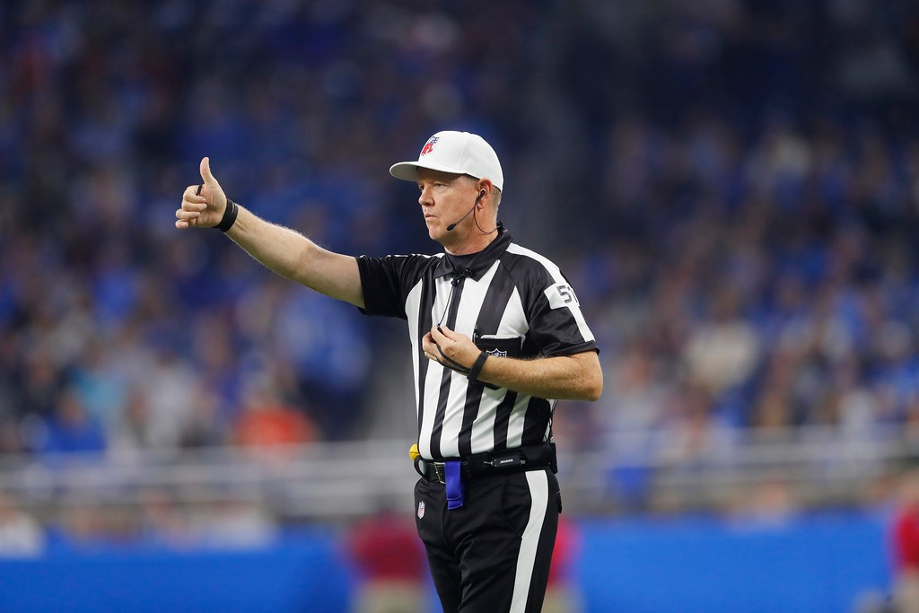 . Referee Carl Cheffers signals during the first half of an NFL football game between the Detroit Lions and the Cleveland Browns, Sunday, Nov. 12, 2017, in Detroit. (AP Photo/Paul Sancya)