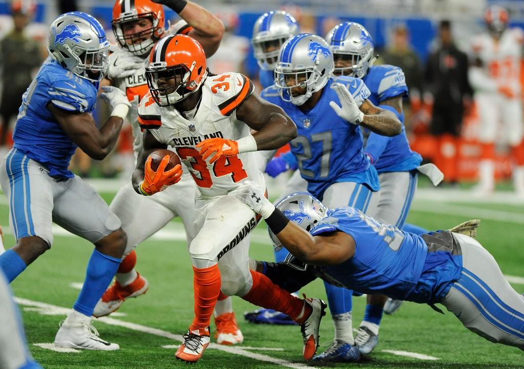 . Cleveland Browns running back Isaiah Crowell (34) rushes through the Detroit Lions defense during the second half of an NFL football game, Sunday, Nov. 12, 2017, in Detroit. (AP Photo/Jose Juarez)