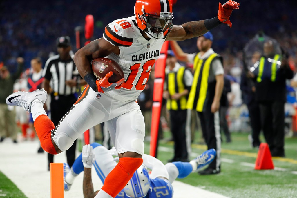 . Cleveland Browns wide receiver Kenny Britt (18) outruns Detroit Lions free safety Glover Quin (27) as he enters the end zone for a touchdown during the first half of an NFL football game, Sunday, Nov. 12, 2017, in Detroit. (AP Photo/Rick Osentoski)