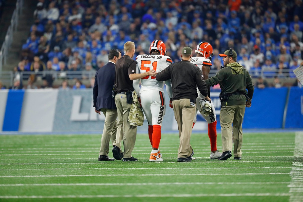 . Cleveland Browns outside linebacker Jamie Collins (51) is helped off the field during the first half of an NFL football game against the Detroit Lions, Sunday, Nov. 12, 2017, in Detroit. (AP Photo/Rick Osentoski)