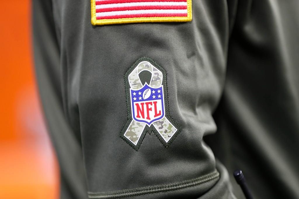 . An National Football League Salute to Service logo is displayed during the first half of an NFL football game against the Cleveland Browns, Sunday, Nov. 12, 2017, in Detroit. (AP Photo/Paul Sancya)