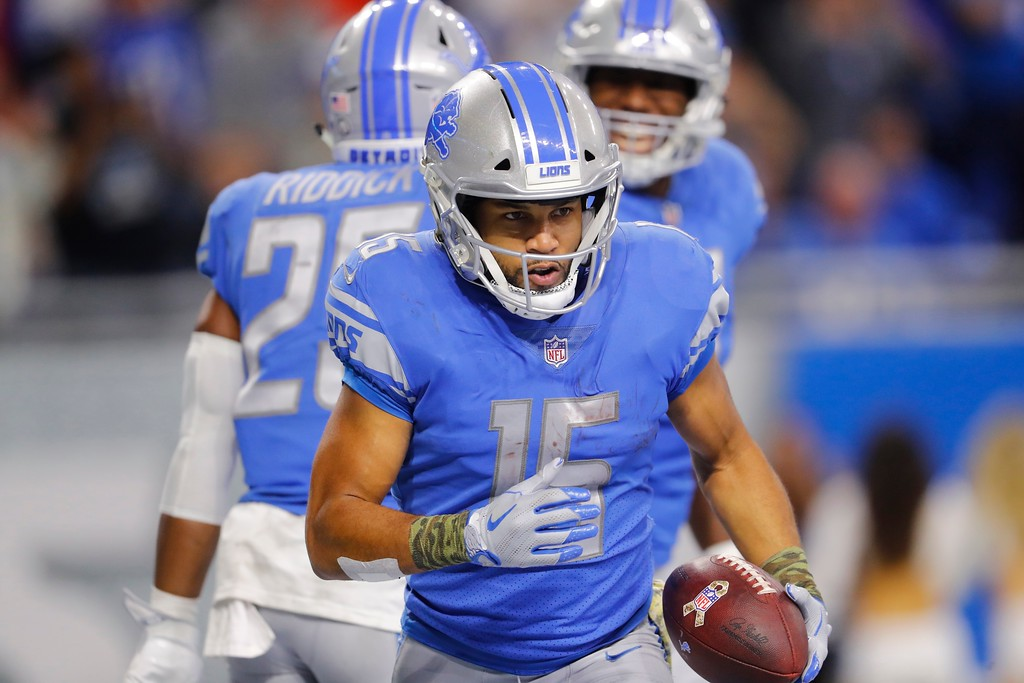 . Detroit Lions wide receiver Golden Tate runs to the bench after a 40-yard rushing touchdown during the second half of an NFL football game against the Cleveland Browns, Sunday, Nov. 12, 2017, in Detroit. (AP Photo/Paul Sancya)