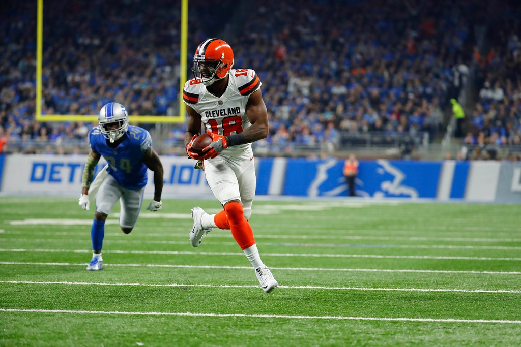 . Cleveland Browns wide receiver Kenny Britt (18) outruns Detroit Lions cornerback Nevin Lawson (24) before running into the end zone for a touchdown during the first half of an NFL football game, Sunday, Nov. 12, 2017, in Detroit. (AP Photo/Rick Osentoski)