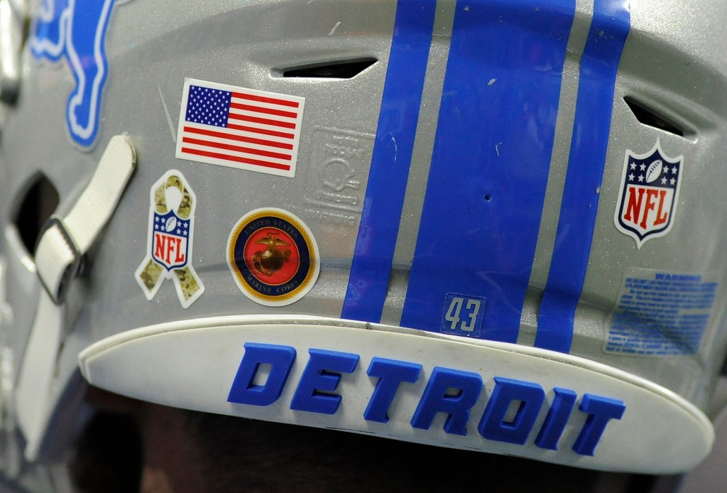 . Detroit Lions middle linebacker Nick Bellore (43) sports an National Football League Salute to Service logo and a logo for the U.S. Marines on his helmet during the second half of an NFL football game against the Cleveland Browns, Sunday, Nov. 12, 2017, in Detroit. (AP Photo/Jose Juarez)