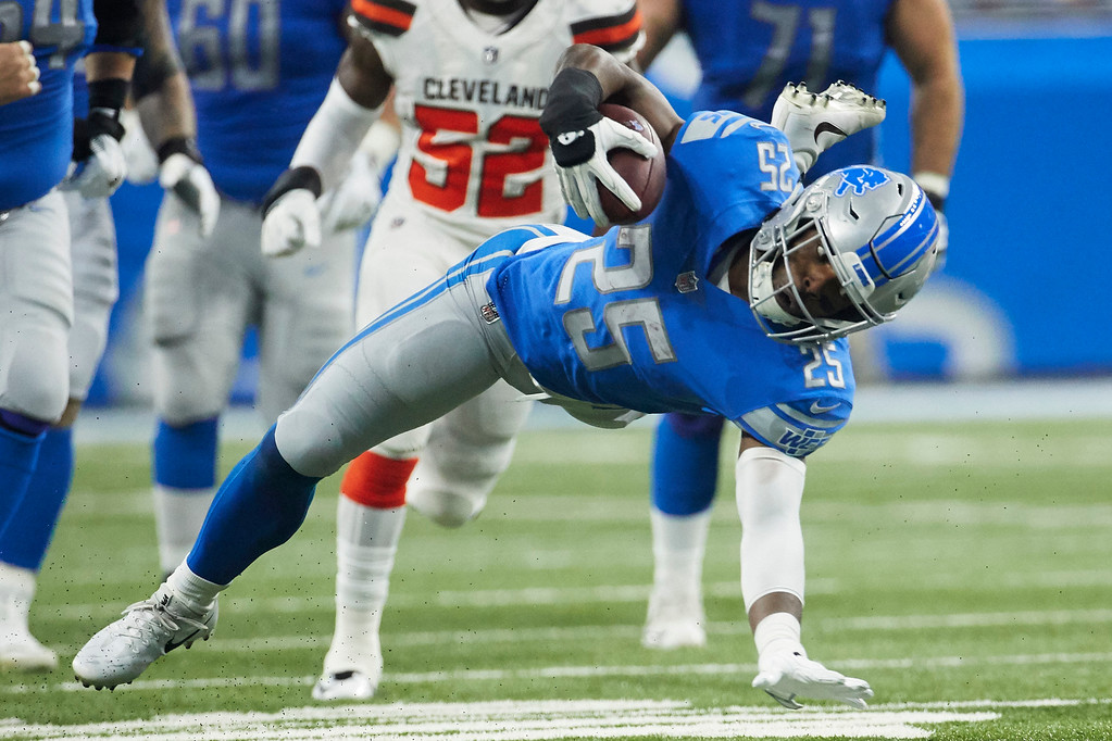 . Detroit Lions running back Theo Riddick (25) is tripped up against the Cleveland Browns during an NFL football game, Sunday, Nov. 12, 2017, in Detroit. (AP Photo/Rick Osentoski)