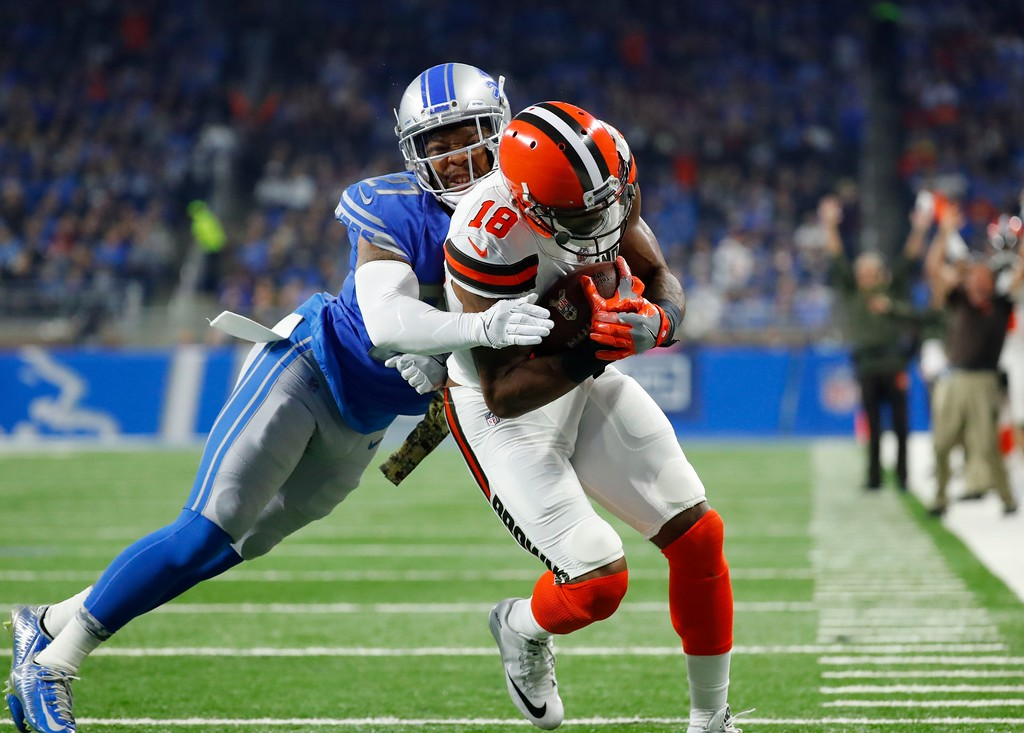 . Detroit Lions free safety Glover Quin (27) tries stopping Cleveland Browns wide receiver Kenny Britt (18) from entering the end zone for a touchdown during the first half of an NFL football game, Sunday, Nov. 12, 2017, in Detroit. (AP Photo/Rick Osentoski)