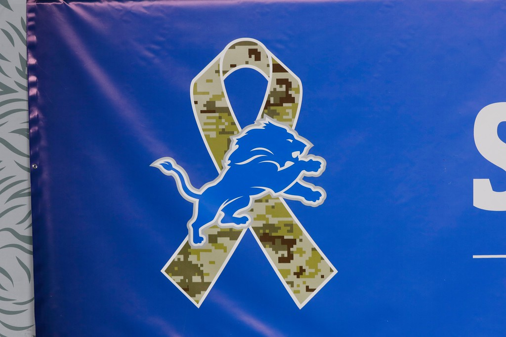 . A Detroit Lions Salute to Service logo is displayed during the first half of an NFL football game against the Cleveland Browns, Sunday, Nov. 12, 2017, in Detroit. (AP Photo/Paul Sancya)