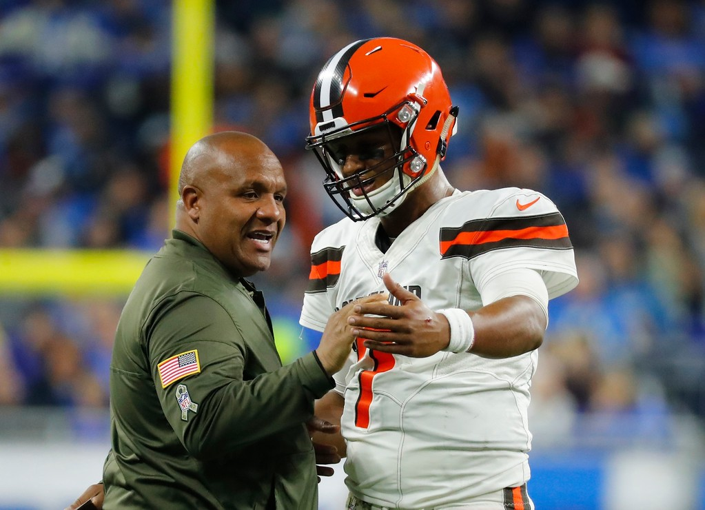. Cleveland Browns head coach Hue Jackson talks with quarterback DeShone Kizer (7) during the first half of an NFL football game against the Detroit Lions, Sunday, Nov. 12, 2017, in Detroit. (AP Photo/Rick Osentoski)