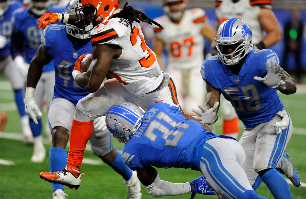 . Cleveland Browns running back Isaiah Crowell (34) rushes for a 6-yard touchdown during the second half of an NFL football game against the Detroit Lions, Sunday, Nov. 12, 2017, in Detroit. (AP Photo/Jose Juarez)