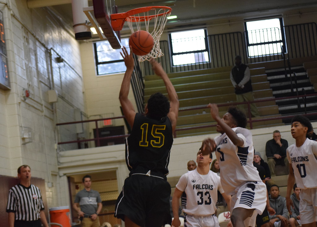 . Detroit MLK topped Farmington, 49-39, in a Class A regional semifinal at U-D Jesuit on Monday. (Photo by Paula Pasche)