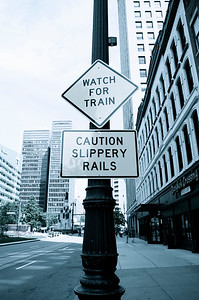 Watch for Train / Caution Slippery Rails