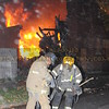 FF. Harris (left) operating at a Detroit 3rd Alarm on October 31, 2008 on Rohns.
