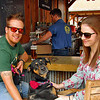 Couple with their pup at the bar