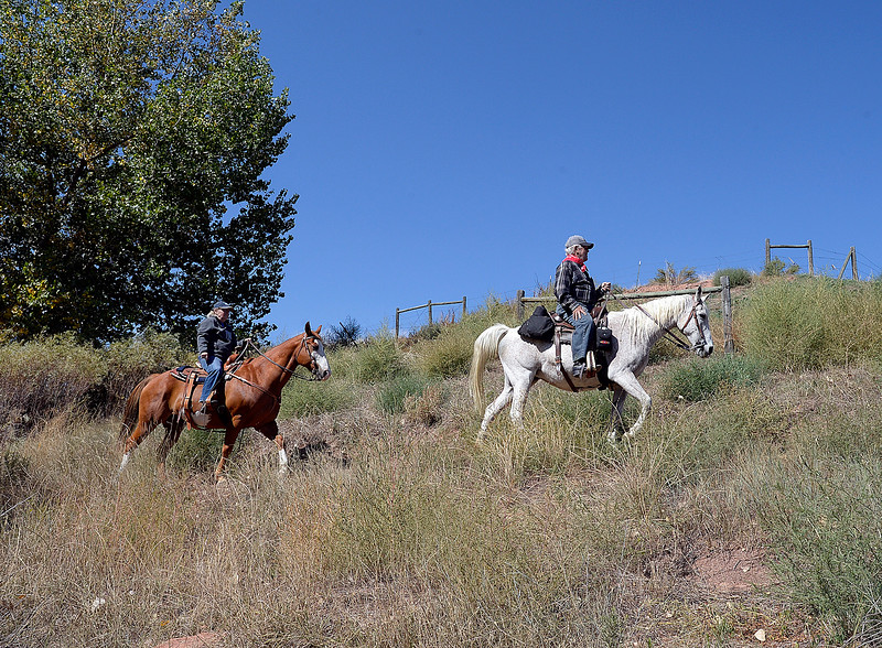 Missy Brown, left, and Ron Fulton, right, ride their horses on a trail Friday, Sept. 21, 2018, at the Devil's Backbone Open Space in Loveland.  (Photo by Jenny Sparks/Loveland Reporter-Herald)