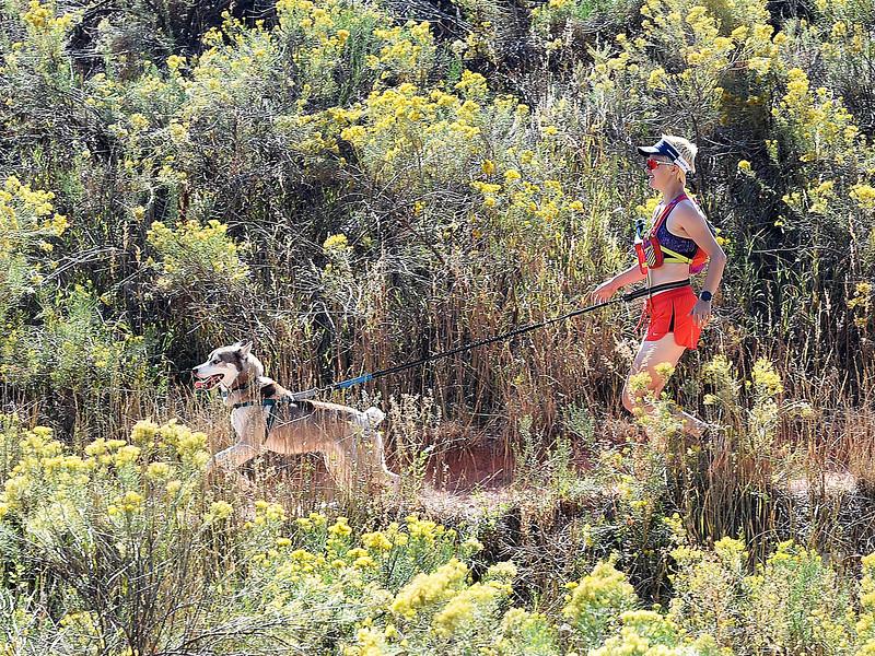 Jessy Nelson runs with her dog, Buddy Nubby on Friday, Sept. 21, 2018, at the Devil's Backbone Open Space in Loveland.  (Photo by Jenny Sparks/Loveland Reporter-Herald)
