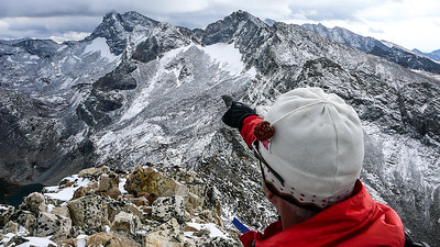 """Terry identifies the next peak: Goat Mountain, the second highest peak in the Pioneer Range. Salzburger Spitzl is to the right of it, with Hyndman Peak """"peeking"""" over Duncan Ridge. Handwerk Peak is visible as the dark angular mountain on the far right."""