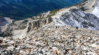 Down the talus.