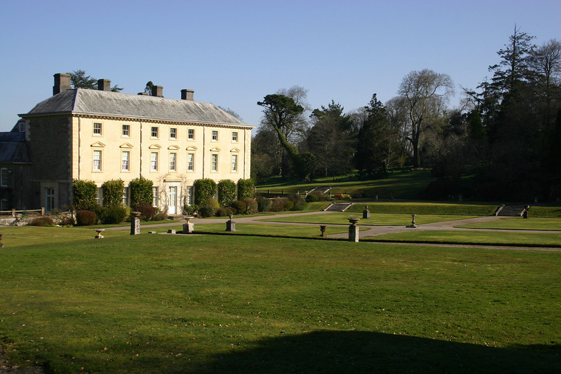 Sunlit views over manicured lawns and pathways