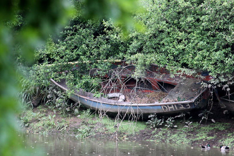 A fishing boat lies abandoned on the bank of the River Dart outside Totnes.