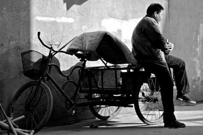 michswiss - A man in sunlight (DSS Round #42: Photojournalism - Exclusive Black and White Challenge)